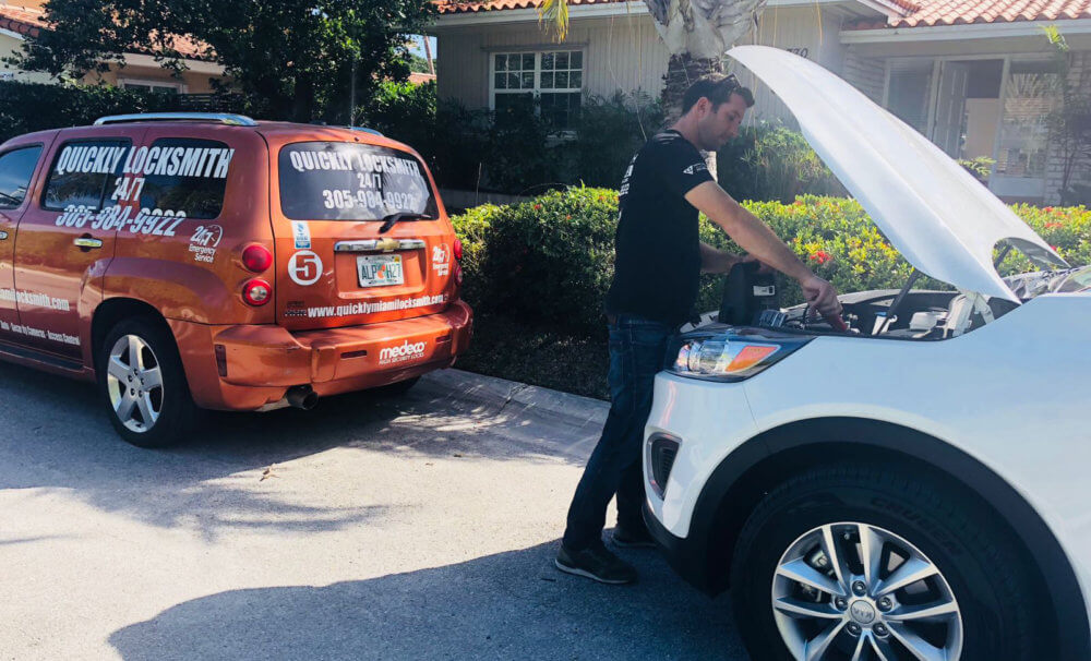 Our locksmith technicians providing roadside assistance services to a car stuck in Miami FL