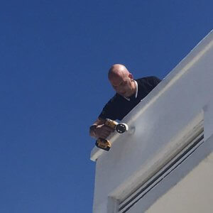 Out locksmith technician looking for the best locations for surveillance cameras & sensors for Miami residential home