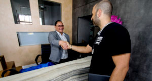 shaking hands with the property manager of our commercial client's reception in Miami