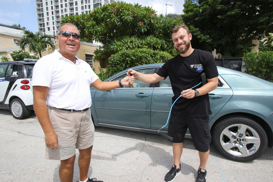happy client after unlocking his car and replacing his car keys in Miami FL