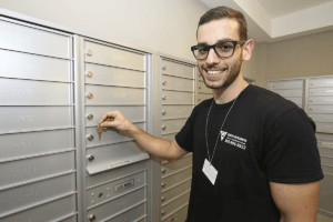 locksmith technician changes key for mail boxes in Miami FL